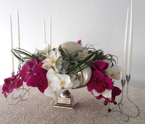 Classic silver elements and elongated taper candles contrasted the modern-esque arrangement beautifully
