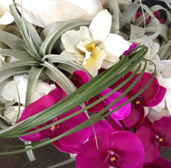 Nautilus shells, air plants and orchids made for a stunning, natural, yet colorful arrangement