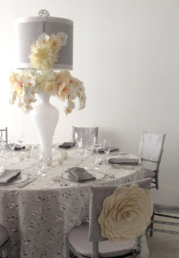 The chair covers helped tie the linen shade and oversized flowers in beautifully