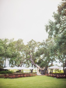 Market umbrellas dotting a beautiful outdoor ceremony. Photo: Tim Willoughby via Southern Weddings